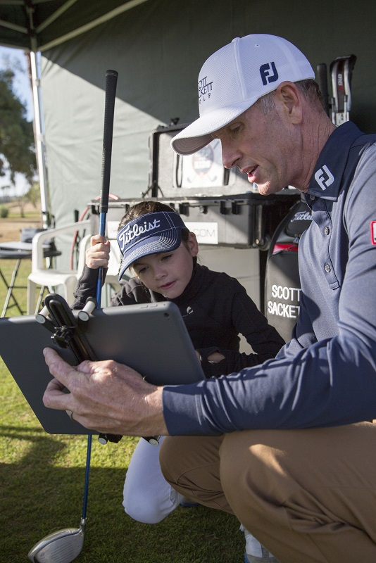 Scott Sackett Golf Instruction with junior player